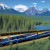 Rocky Mountaineer in the Canadian Rockies. Location is at Morant's Curve near Lake Louise, Alberta.